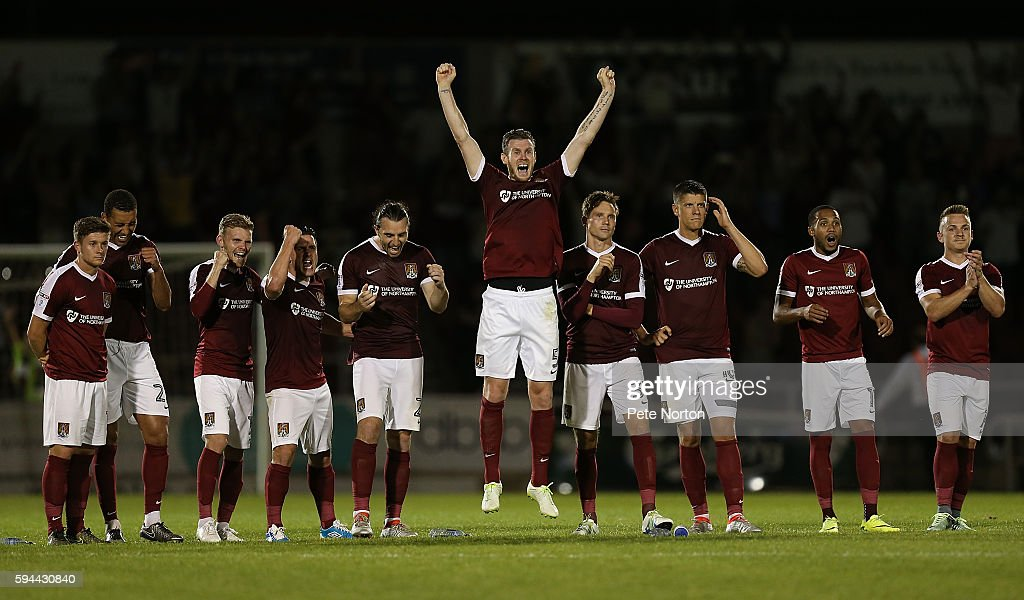 Northampton Town players celebrate after Adam Smith had saved a penalty taken by James Morrison of West Bromwich Albion during a penalty shoot out...