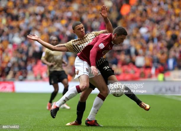 Northampton Town's Ben Tozer and Bradford City's Nahki Wells battle for the ball