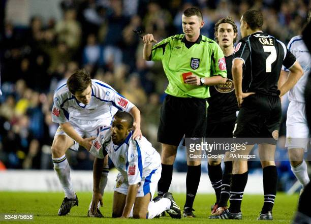 Northampton Town's Giles Coke is sent off by referee Michael Oliver after fouling Leeds United's Fabian Delph during the FA Cup First Round match at...