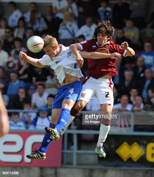 Northampton Town's Guillem Bauza and Bury's Tom Lees battle for the ball during the npower League Two match at Sixfields Stadium Northampton