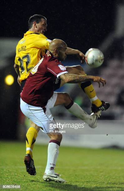 Northampton Town's Leon McKenzie and Stockport County's Tom Aldred during the npower League Two match at Sixfields Stadium Northampton