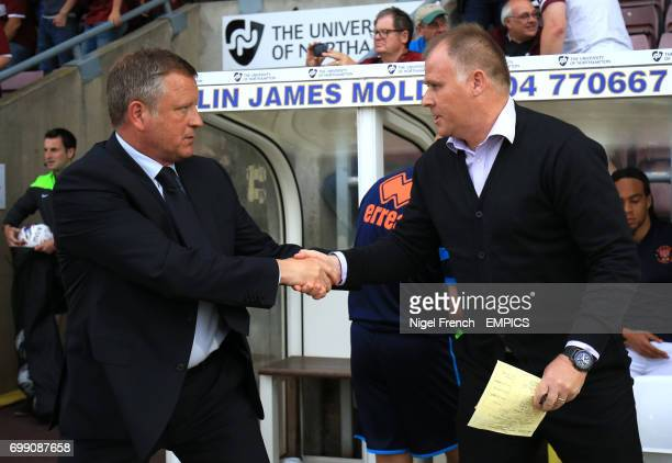 Northampton Town's manager Chris Wilder and Blackpool's manager Neil McDonald shake hands before the game