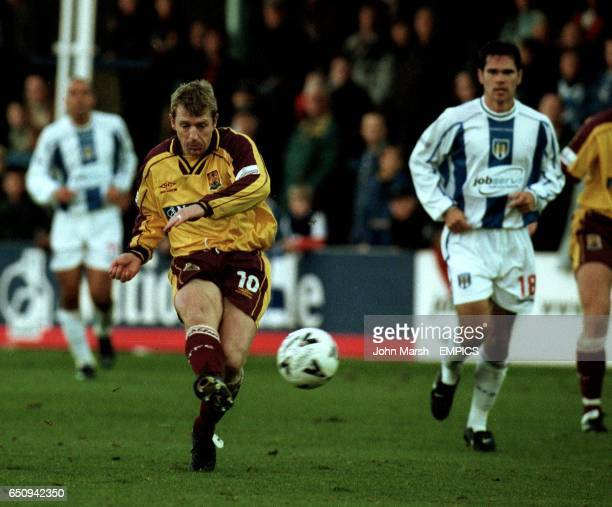 Northampton Town's Marco Gabbiadini fires in a shot