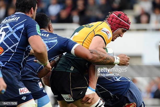 Northampton's British lock Christian Day runs with the ball during the European Cup rugby union match between Castres Olypimque and Northampton...