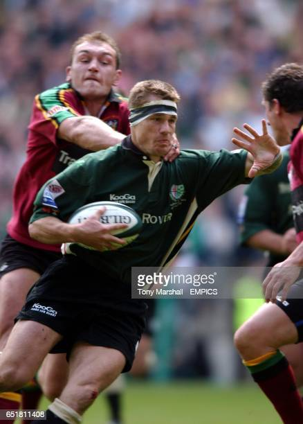 Northampton's Johan Ackermann and Paul Grayson tackle London Irish's Michael Horak