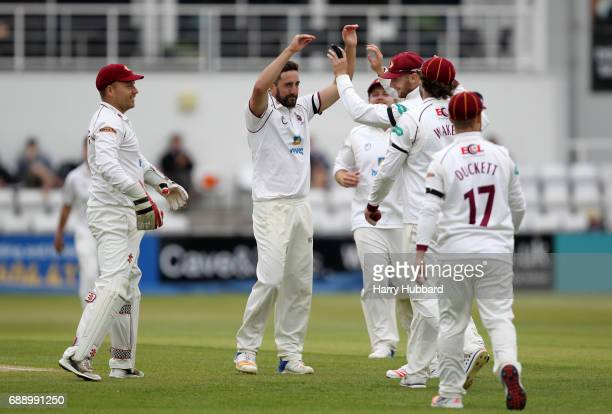 Northamptonshire celebrate the wicket of Tom KohlerCadmore of Worcestershire during the Specsavers County Championship division two match between...