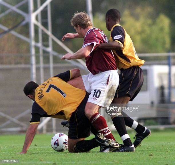Northamton Town's Marco Gabbiadini tries to make a way through the Cambridge United defence of Paul Wanless and Dean Walling during the Nationwide...