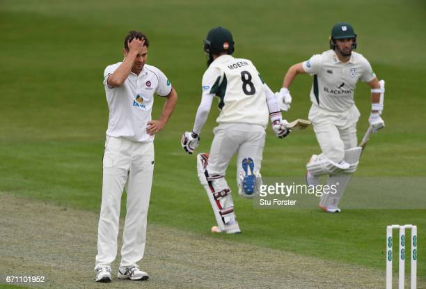 Northants bowler Nathan Buck reacts as Worcestershire batsman Moeen Ali picks up some runs during day one of thr Specsavers County Championship...