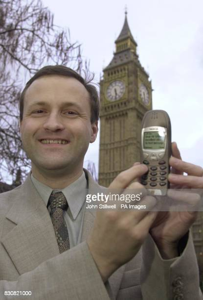 Northavon MP Steve Webb who has claimed that he will be the first in the country whose constituents can contact him by textmessage holds his phone...
