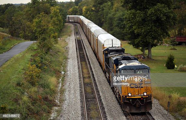 A northbound CSX Corp auto rack freight train approaches Campbellsburg Kentucky US on Thursday Oct 1 2015 CSX Corp is scheduled to release quarterly...