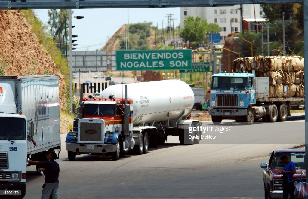 Northbound trucks cross the border to enter the United States from Nogales, Sonora, Mexico, August 1, 2001 near Nogales, AZ. In defiance of veto threats from the White House and warnings from Mexico, the Senate approved a $60.1 billion bill that would subject Mexican truckers to increased inspections, insurance, and other requirements before entering the U.S.
