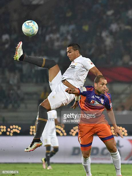 Northeast United FC's defender Mailson Alves vies for the ball with FC Pune Citys defender Eduardo Ferreira during the Indian Super League football...