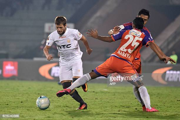 Northeast United FC's forward Emiliano Alfaro vies for the ball with FC Pune Citys defender Narayan Das during the Indian Super League football match...
