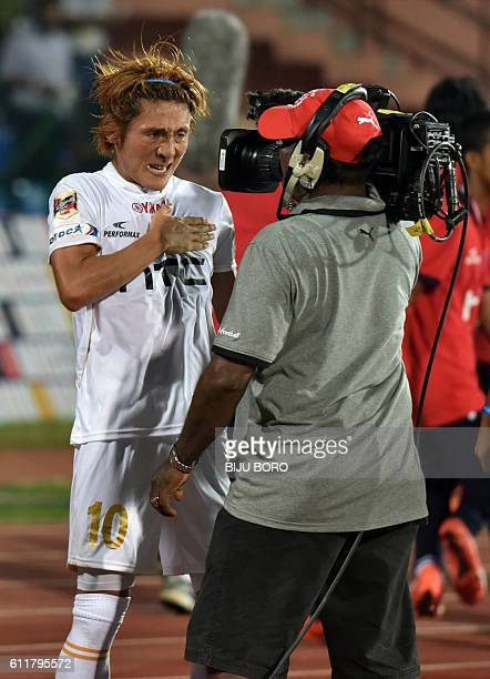 Northeast United FC's midfielder Katsumi Yusa celebrates after scoring a goal during the Indian Super League football match between Northeast United...