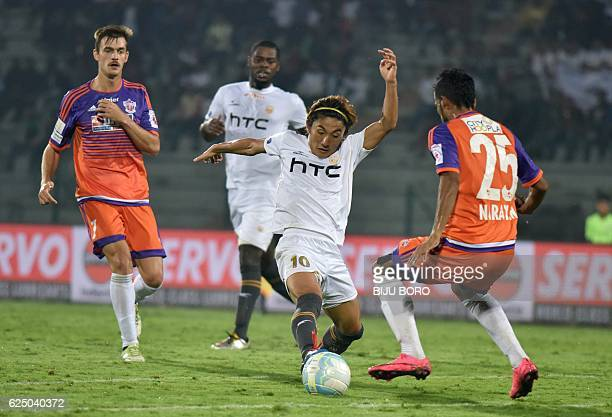 Northeast United FC's midfielder Katsumi Yusa vies for the ball with FC Pune Citys defender Narayan Das during the Indian Super League football match...
