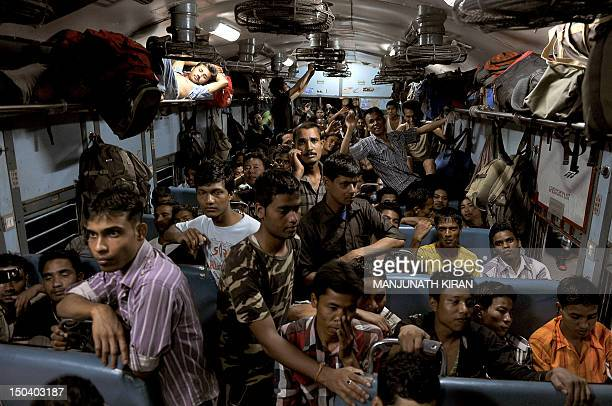 Northeastern Indian minority residents of Bangalore wait in a train bound for Guwahati to leave the city following rumours of communal violence...