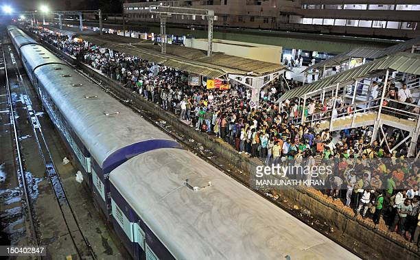 Northeastern Indian minority residents of Bangalore wait on the platform of the city railway station to board trains bound to Guwahati to leave the...