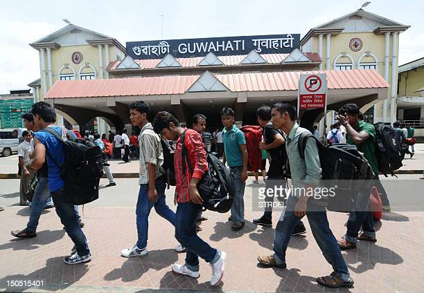 Northeastern Indian residents leave a railway station after disembarking from a special train from Bangalore city at Guwahati Railway Station in...