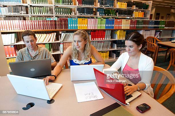 Northeastern University students Amanda Horton red dress of Queensburt NY Allison Bubly of Somerset MA and Scott Osheroff of Palos Verdes CA studying...