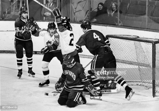 Northeastern University's Charlie Huck celebrates scoring a goal against Harvard University's Brian Petrouek during the consolation game of the...