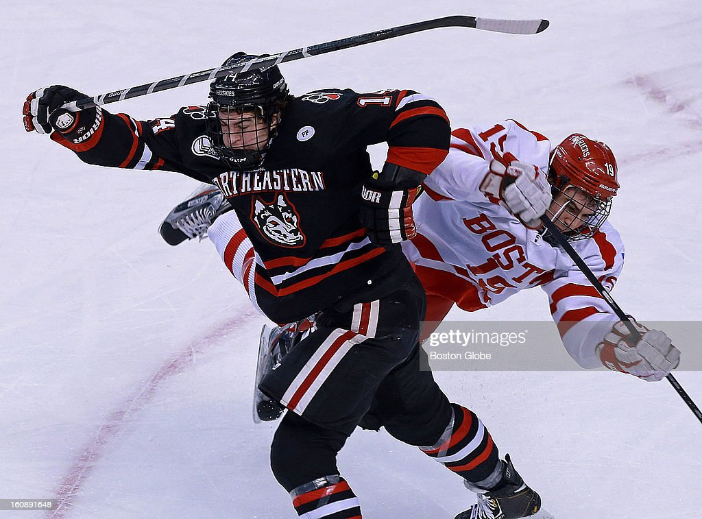 Northeastern's Braden Pimm, left, got two minutes for elbowing for this hit that sent Boston University's Ryan Santana, right, flying to the ice, first period action. Northeastern University met Boston University in the early game of the annual Beanpot Hockey Tournament at the TD Garden.