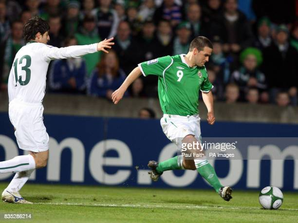 Northen Ireland's David Healy battles with Slovenia's Bojan Jokic during the World Cup Qualifying match at Windsor Park Belfast