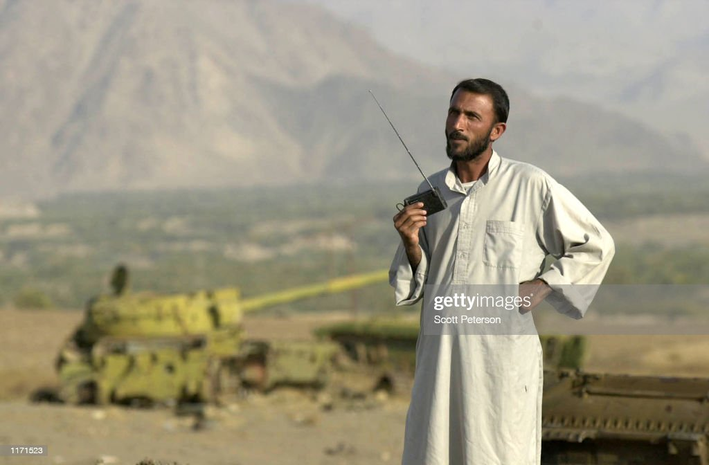 Northern alliance fighter on the rebel side of the front line 40 miles north of the capital listens to a radio near a military depot October 27 2001...