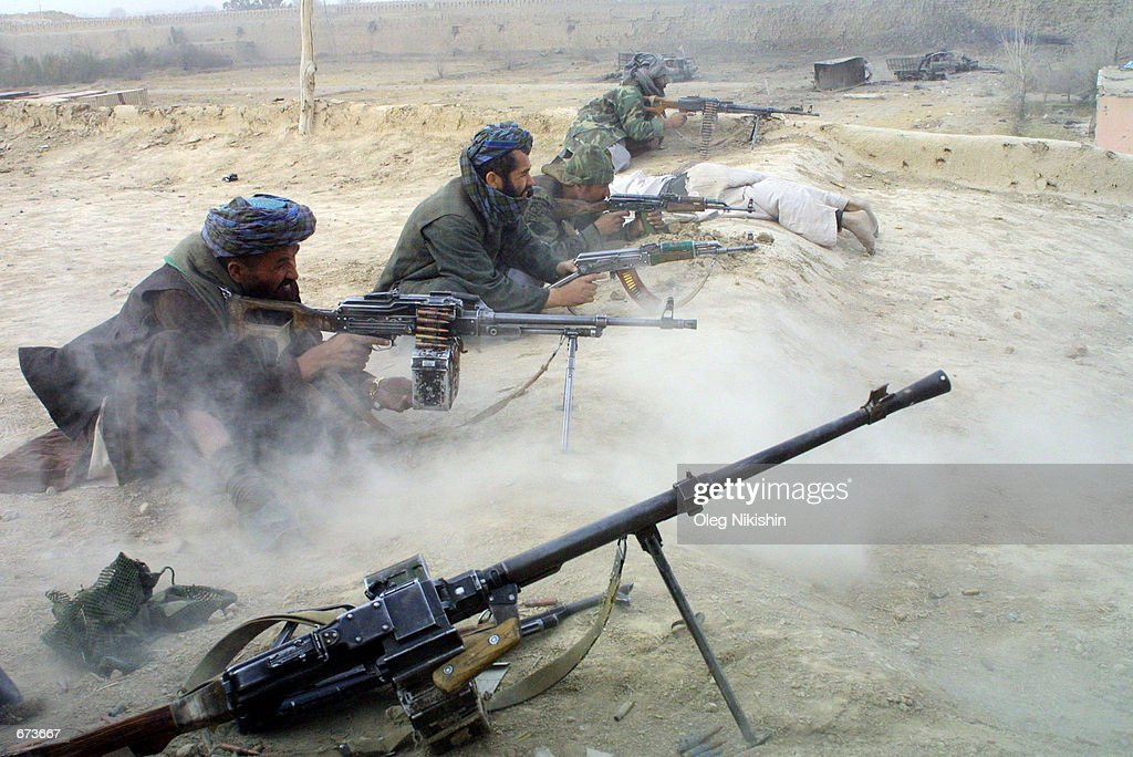 Northern Alliance fighters battle proTaliban forces November 27 2001 in a fortress near MazareSharif Afghanistan The Northern Alliance helped by US...