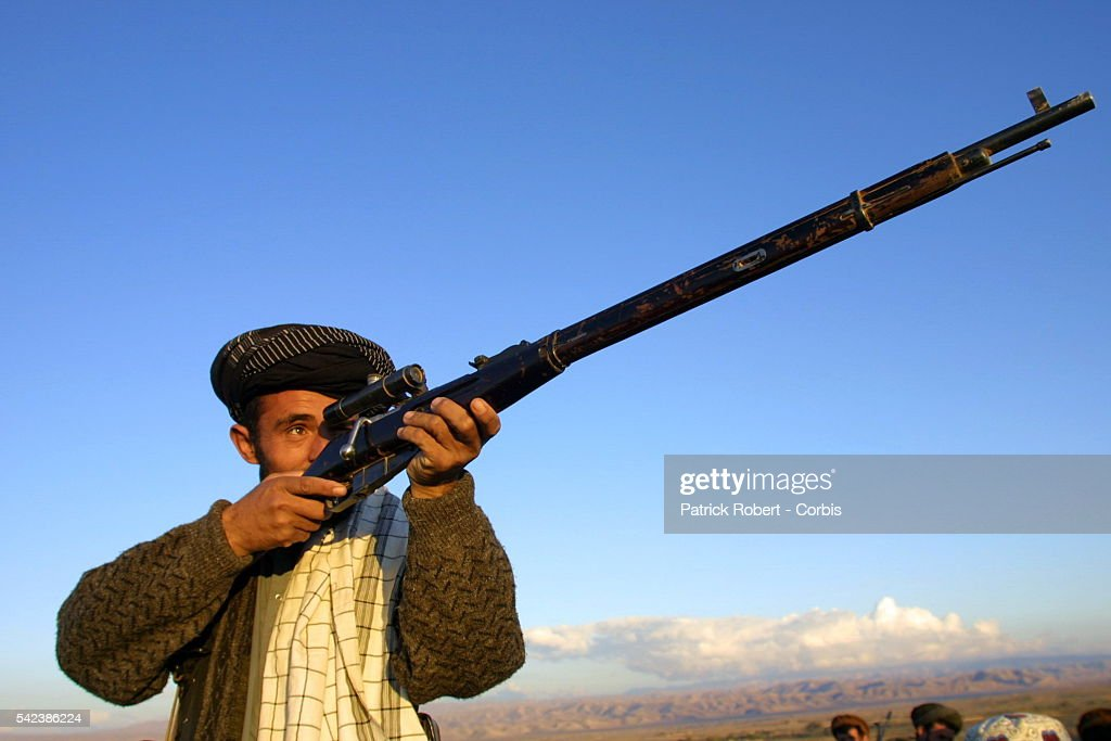 A Northern Alliance sniper armed with an old precision gun on the front at Kalakata