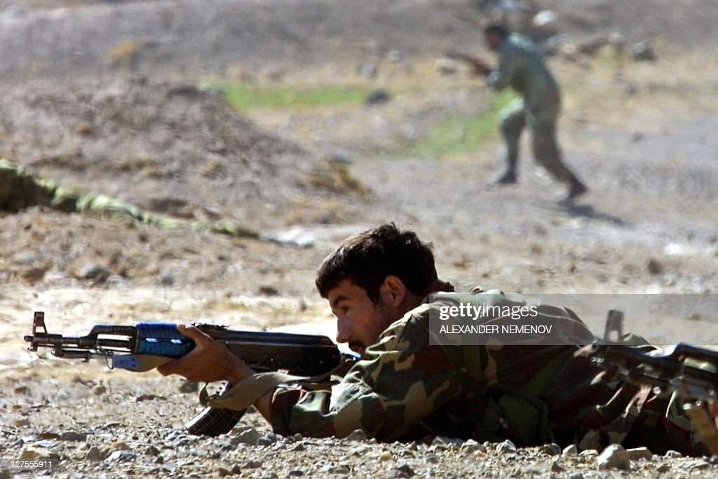 Northern Alliance soldier covers his comrade as the second one changes his position not far from the town of Baghram some 25 kms north from Kabul 10...