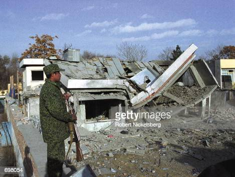 Northern Alliance soldier looks at the destroyed Al Jazeera television networks Kabul headquarters December 6 2001 in Afghanistan The TV station was...