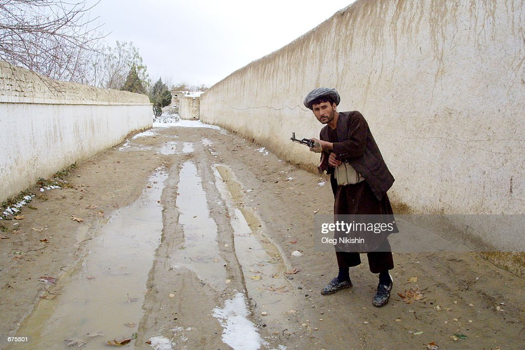 Northern Alliance soldier walks along the streets of the ancient city of Balkh the last pocket of Taliban resistance in northern Afghanistan which...