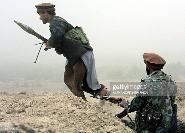 Northern Alliance soldiers change their position in a sand storm 700 metres from the Taliban lines not far from the village of Quruq Northern...