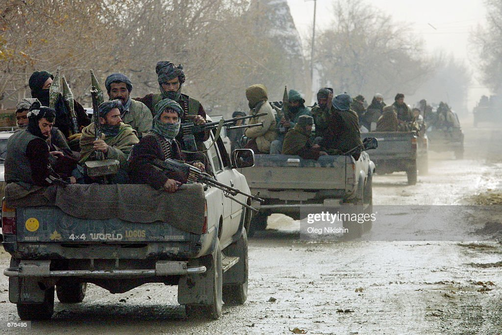 Northern Alliance soldiers travel along the roads of the ancient city of Balkh the last pocket of Taliban resistance in northern Afghanistan which...