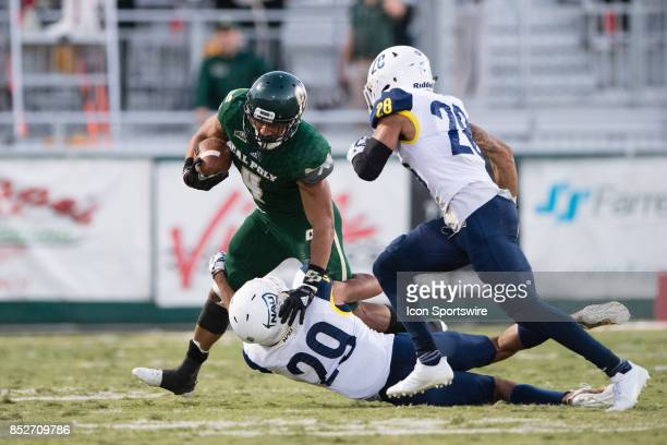 Northern Arizona Lumberjacks cornerback Khalil Dorsey tackles Cal Poly Mustangs running back Kyle Lewis as he attempts to turn up field during the...