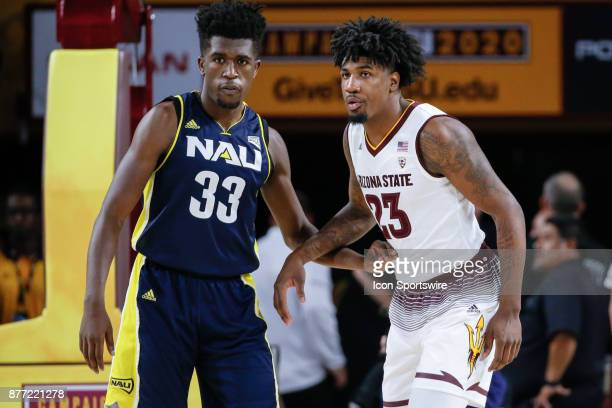 Northern Arizona Lumberjacks forward Isaiah Thomas and Arizona State Sun Devils forward Romello White fight for position during the college...