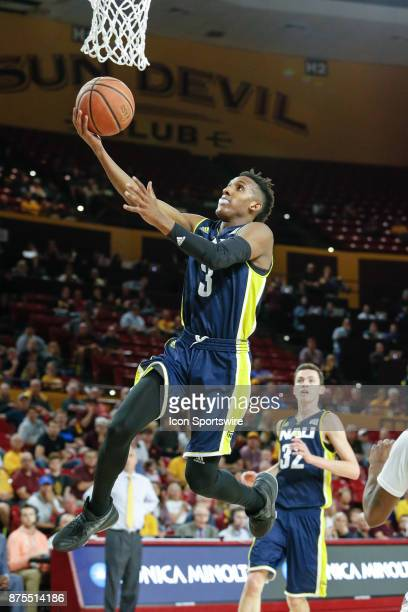 Northern Arizona Lumberjacks guard Gino Littles goes up for a lay up during the college basketball game between the Northern Arizona Lumberjacks and...