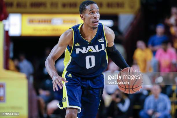 Northern Arizona Lumberjacks guard Torry Johnson moves the ball up court during the college basketball game between the Northern Arizona Lumberjacks...