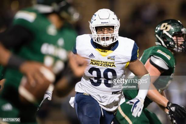 Northern Arizona Lumberjacks linebacker Taylor Powell goes after Cal Poly Mustangs quarterback Khaleel Jenkins during the game between the Northern...