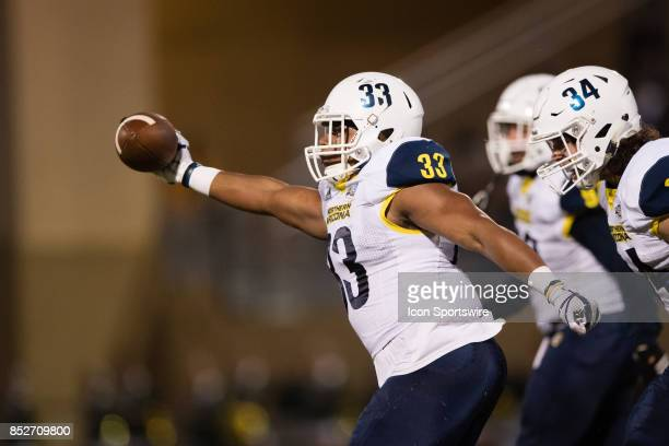 Northern Arizona Lumberjacks linebacker Tristen Vance celebrates after recovering a fumble during the game between the Northern Arizona Lumberjacks...