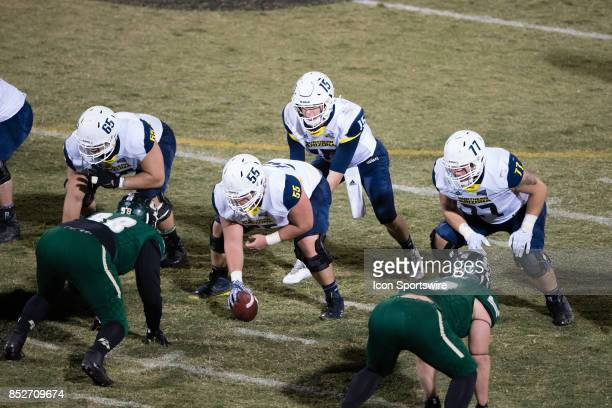 Northern Arizona Lumberjacks quarterback Case Cookus gets ready for the snap under Northern Arizona Lumberjacks offensive lineman Blake Porter during...