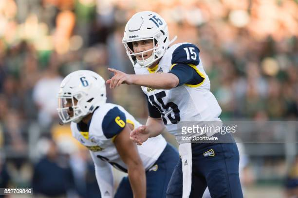 Northern Arizona Lumberjacks quarterback Case Cookus points to the defense during the game between the Northern Arizona Lumberjacks and the Cal Poly...