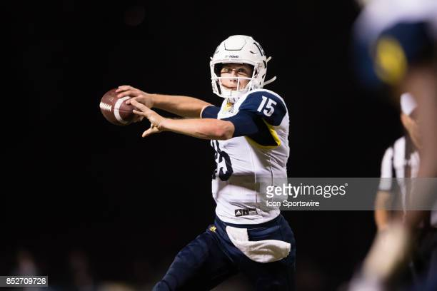 Northern Arizona Lumberjacks quarterback Case Cookus rolls out of the pocket and passes the ball during the game between the Northern Arizona...