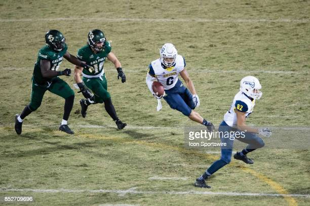 Northern Arizona Lumberjacks running back Cory Young runs to the outside during the game between the Northern Arizona Lumberjacks and the Cal Poly...