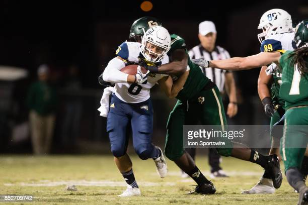 Northern Arizona Lumberjacks running back Cory Young runs up the middle during the game between the Northern Arizona Lumberjacks and the Cal Poly...