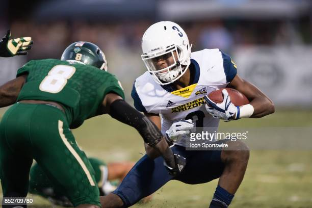 Northern Arizona Lumberjacks wide receiver Elijah Marks makes a cut on Cal Poly Mustangs defensive back Kitu Humphrey during the game between the...
