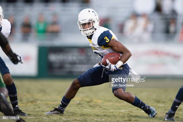 Northern Arizona Lumberjacks wide receiver Elijah Marks makes a cut while running the ball during the game between the Northern Arizona Lumberjacks...