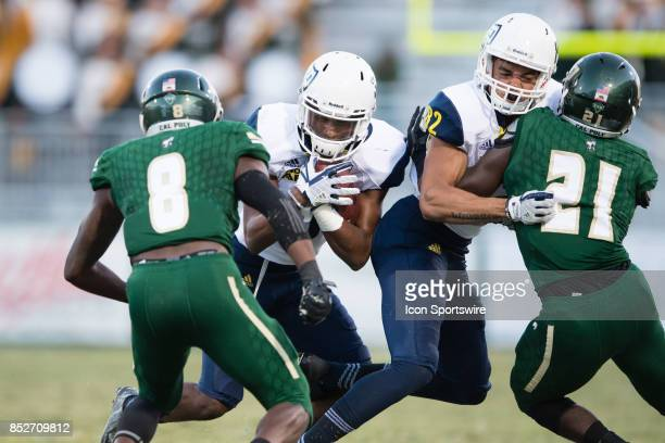 Northern Arizona Lumberjacks wide receiver Elijah Marks runs the ball while Northern Arizona Lumberjacks wide receiver Chance Brewington blocks Cal...