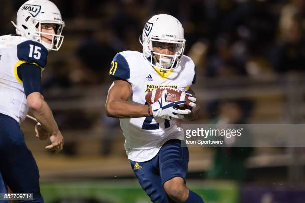 Northern Arizona Lumberjacks wide receiver William Morehand runs the ball to the outside during the game between the Northern Arizona Lumberjacks and...