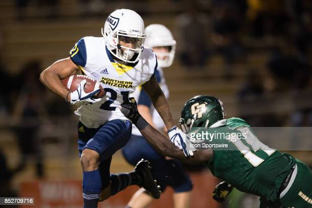 Northern Arizona Lumberjacks wide receiver William Morehand throws a block as he runs to the outside during the game between the Northern Arizona...